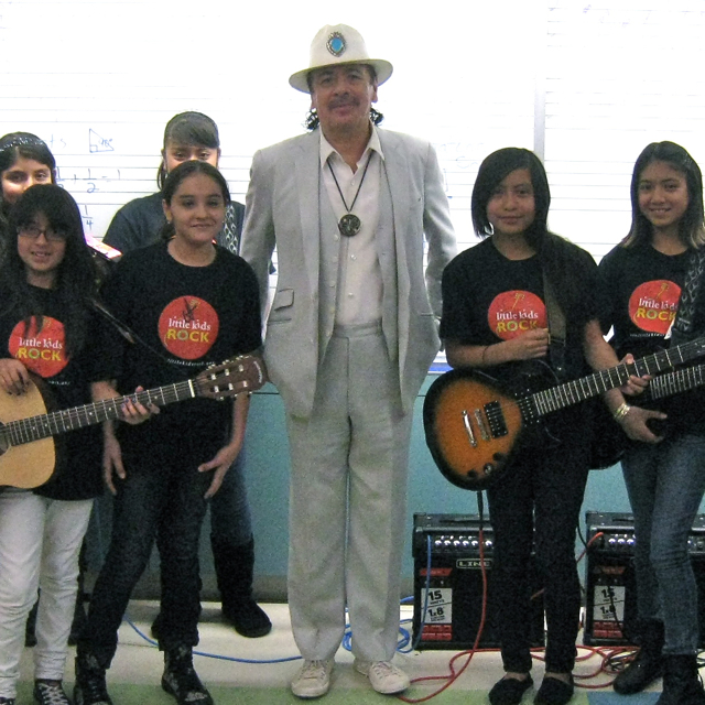 Carlos Santana hanging with Little Kids Rock