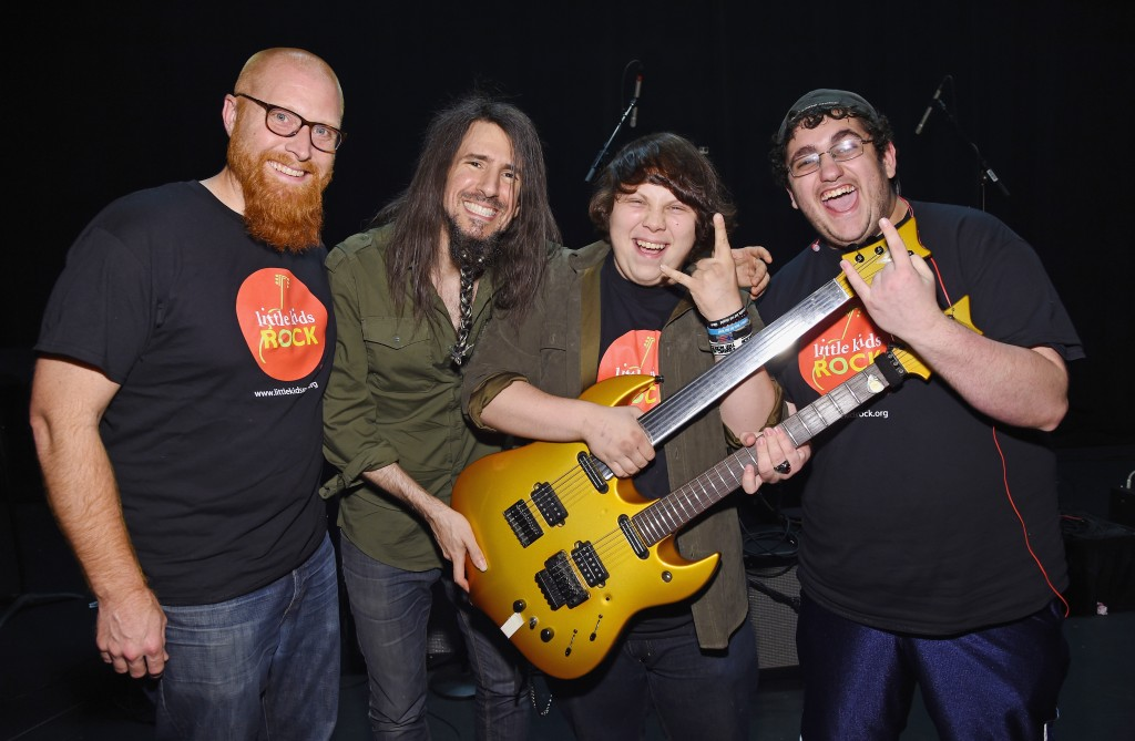 Max Sperber (Far right) Posing with Bumblefoot, Paris, and his class mate at the Big Kids Rock Battle of the Bands