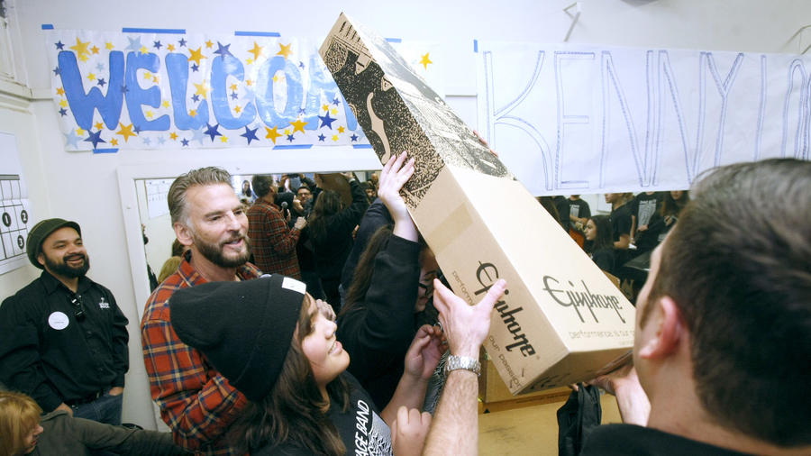 Wilson Middle School Modern Band students open up boxes of Epiphone guitars donated by Little Kids Rock and Kenny Loggins. Photo Credit Raul Roa / LA Times Staff Photographer