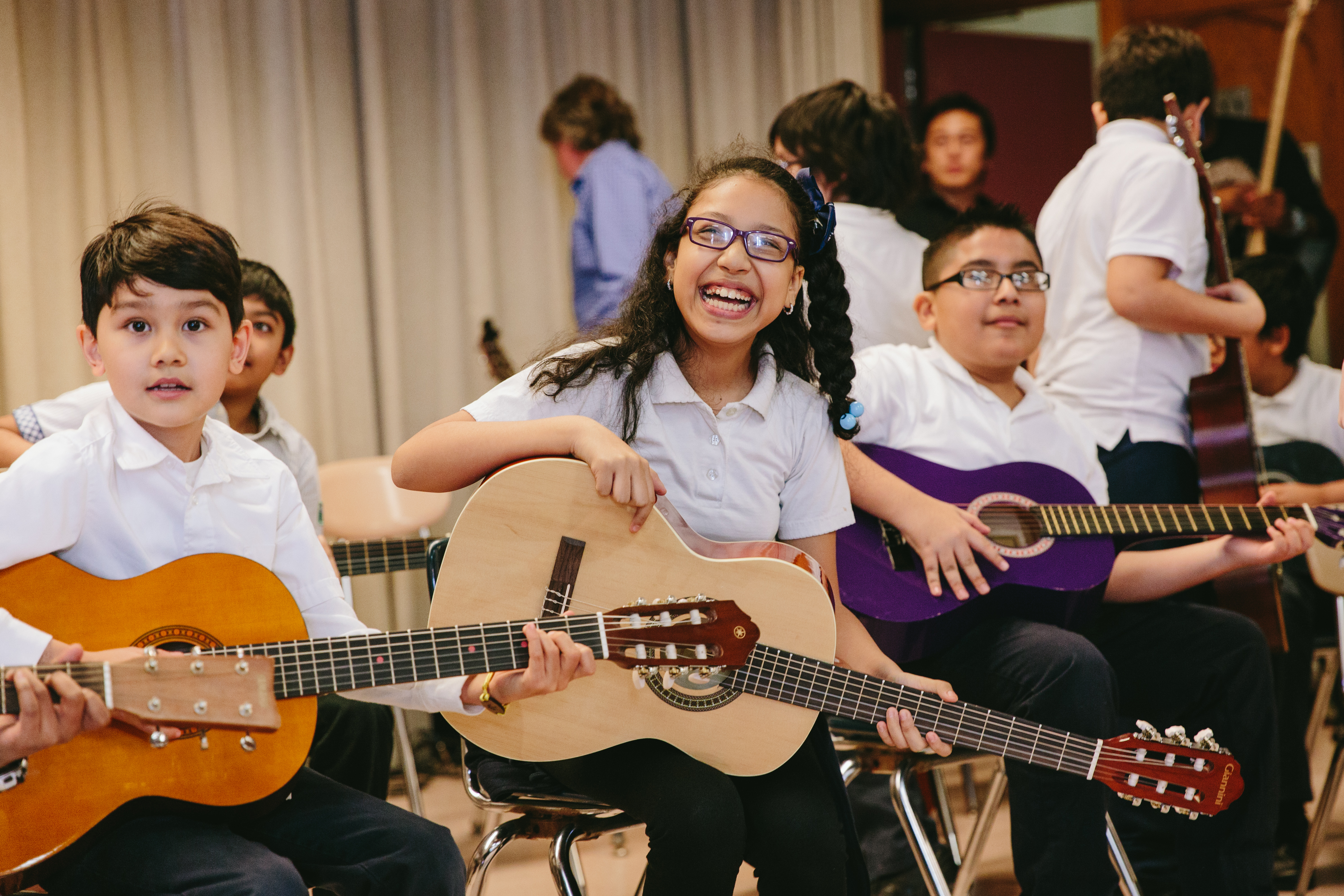 Smiling Little Kids Rock student with guitar
